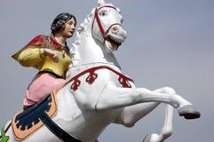 Rummelplatz-Pferd u. Reiter stockfotografie