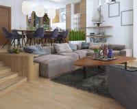 Rummet är en studio med kök och en uppehälle r för äta middag område och Royaltyfri Fotografi