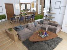 Rummet är en studio med kök och en uppehälle r för äta middag område och Arkivfoton