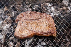 Rump steak on barbecue Royalty Free Stock Photos