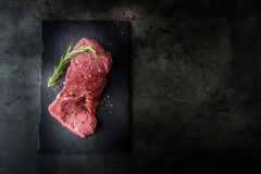 Rump Steak. Beef raw steak. Beef raw steak with salt pepper rosemary butcher and fork Stock Image