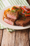 Rump steak in breadcrumbs and fresh vegetables, baked potatoes c. Fried rump steak in breadcrumbs and fresh vegetables, baked potatoes close up on the table Royalty Free Stock Photo