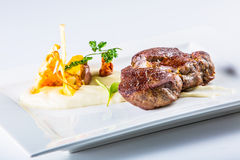 Rump steak. Close up Tender Grilled Beef Meat on White Plate with vegetable decoration. Stock Photography