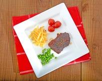 Rump steak dinner Stock Photography
