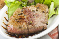 Rump steak with green pepper Royalty Free Stock Image