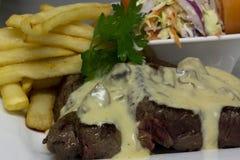 Rump steak with mushroom sauce meal Stock Images