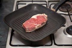 Rump steak in pan Royalty Free Stock Photography