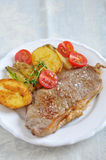 Rump Steak with potato wedges Royalty Free Stock Images