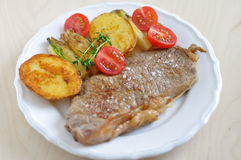 Rump Steak with potato wedges Royalty Free Stock Image