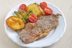 Rump Steak with potato wedges. Grilled rump steak with potato wedges Royalty Free Stock Image