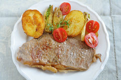 Rump steak. With potatoes and vegetables Stock Photos