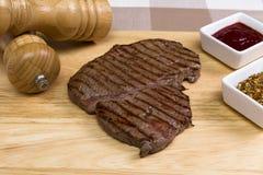 Rump steak. Raw rump steak on a chopping board Stock Image