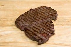 Rump steak. Raw rump steak on a chopping board Royalty Free Stock Image
