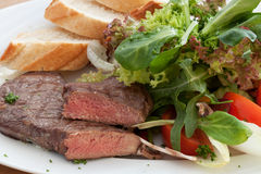 Rump steak with salad. And bread Stock Photos