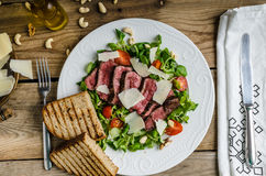 Rump steak with spicy herb butter Royalty Free Stock Photography