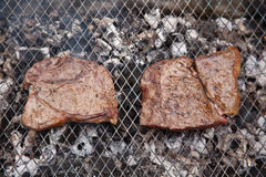 Rump steaks on barbecue Royalty Free Stock Image