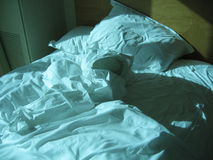Rumpled bed Stock Images