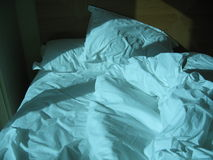 Rumpled bed Royalty Free Stock Image