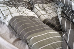 Rumpled bed comforter and sheets Royalty Free Stock Photography