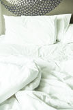 Rumpled bed Stock Photography