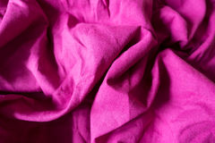 Rumpled bright fuchsia colored linen fabric Royalty Free Stock Photo