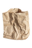 Сrumpled brown paper bag isolated on white Stock Images