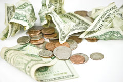 Rumpled dollars and coins Stock Photos