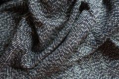 Rumpled salt and pepper tweed fabric Stock Image