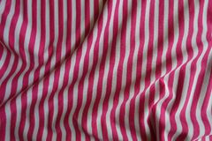 Rumpled striped fabric in pink and white. From above Stock Image