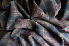 Rumpled thick plaid fabric in subdued colors. Rumpled thick plaid fabric  in subdued colors Royalty Free Stock Image