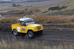 Rumpled 4wd sportcar racing on track. Stock Photo