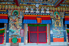 Rumtek Monastery Interior. Paintings in the wall and ceiling and thangkas in interior decoration of Rumtek Monastery. It is famous for its extensive collection Stock Photography