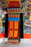Rumtek Monastery Interior. Paintings in the wall and ceiling and thangkas in interior decoration of Rumtek Monastery. It is famous for its extensive collection Royalty Free Stock Image