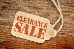 Räumungsverkaufzeichen auf einem Papier-Preis Lizenzfreies Stockfoto