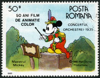 RUMUNIA - 1986: przedstawienia Mickey Mouse, Walt Disney charaktery w zespołu koncercie, 1935, poświęcać pięćdziesiąt rok kolory A Obrazy Royalty Free