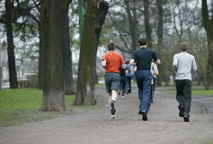 Run 1. Teenagers engaged in run. A lesson of physical culture. Street. Run Stock Photos