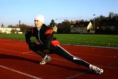 Run #1. A running woman on a stadium stock photo