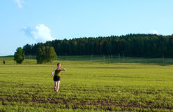 Run!. Girl running in the field Royalty Free Stock Photography