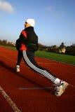 Run #3. A running woman on a stadium stock images