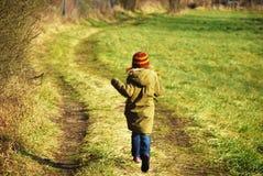 Run !. Little girl running on field Stock Image