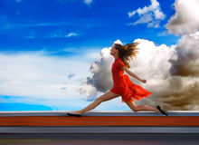 Run. Ning on the roof of a young woman Stock Image