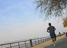 Run along a river. Runner in Riverside Park, NYC Stock Photos