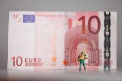 Run away from money Stock Image