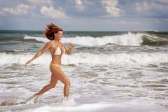 Run at the beach Stock Image