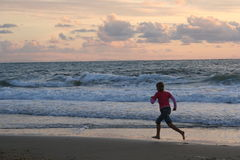 Run on the beach stock photography