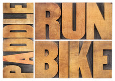 Run, bike, paddle - triathlon concept Royalty Free Stock Photography