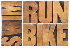 Run, bike, swim - triathlon concept. Isolated word abstract in vintage letterpress wood type Royalty Free Stock Image