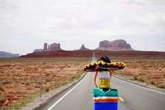Cinco de Mayo beer bottle running from Monument Valley, Utah. Run bottle run! This beer bottle is wearing a sombrero and a poncho and is running in the iconic
