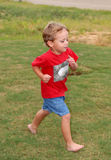 Run Boy Run!. A young boy having fun playing in the grass in his yard Stock Photos