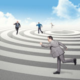 Run in circle. Business people run on 3d spiral Stock Images
